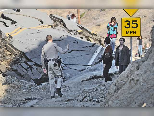 SCV's buckled road still attracting sightseers