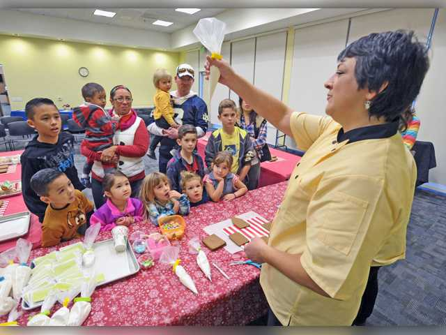 Kids make gingerbread houses Saturday at Canyon Country library