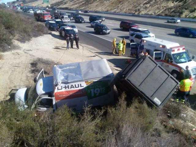 U-Haul overturns on Highway 14