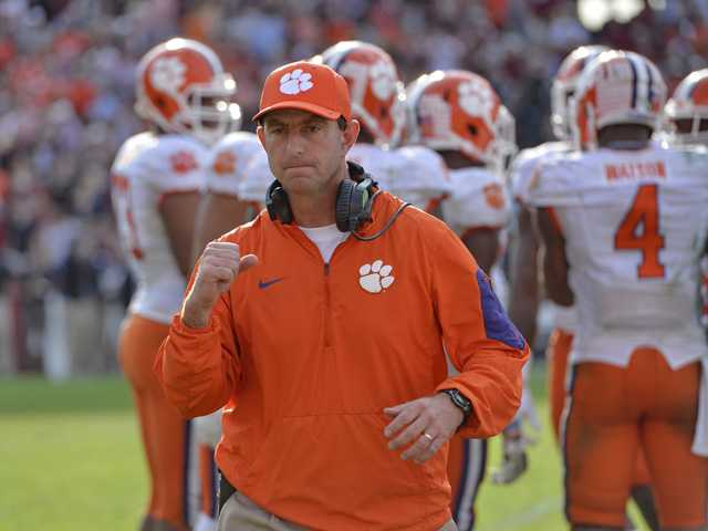 Nov. 28, 2015 file photo, Clemson head coach Dabo Swinney reacts in the closing minutes of a game against South Carolina in Columbia, S.C.