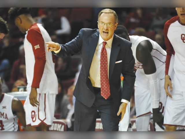 Oklahoma Head basketball coach Lon Kruger instructs his team from the bench during the first half against Creighton in Norman, Okla. on Saturday.