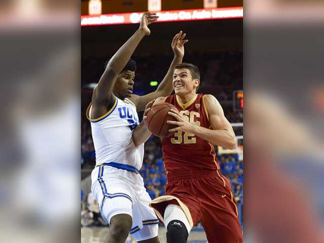 Southern California forward Nikola Jovanovic (32) gets past UCLA forward Tony Parker (23) as he drives to the basket Wednesday at Pauley Pavilionin in Los Angeles.