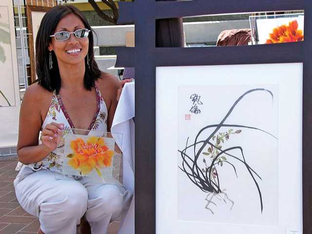 Karen Mills and her art. Courtesy photo