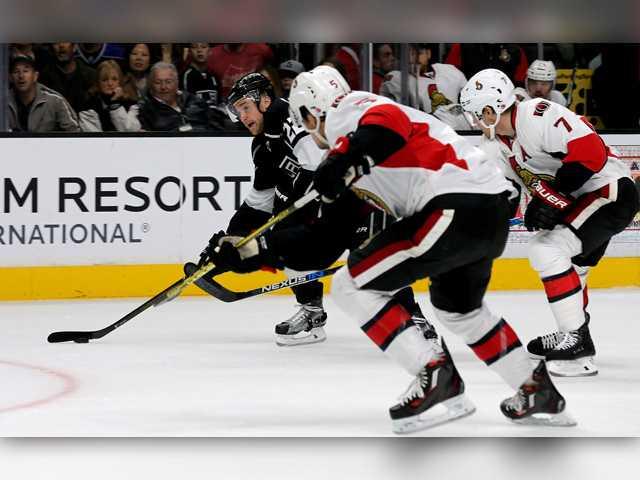 Senators score four late goals, stun Kings
