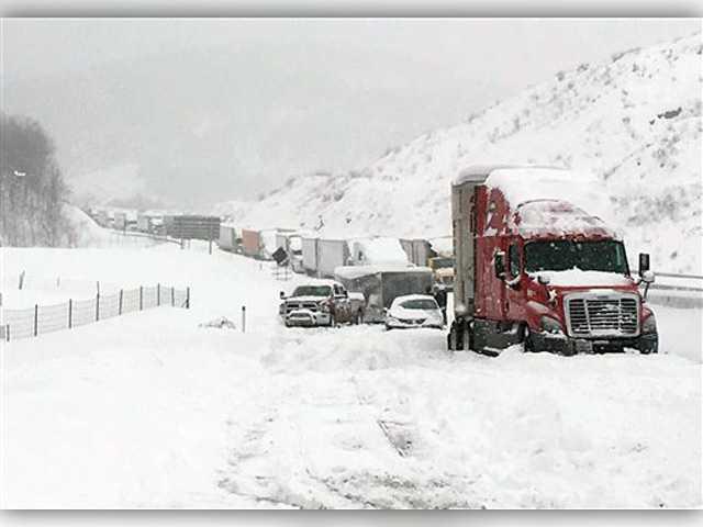 Snowstorm postpones 2 NHL games, strands 2 college teams