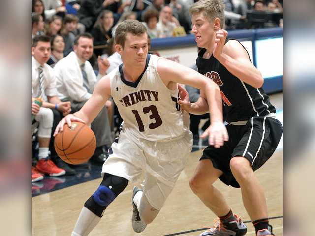 Trinity basketball keeps upper hand on rival SCCS