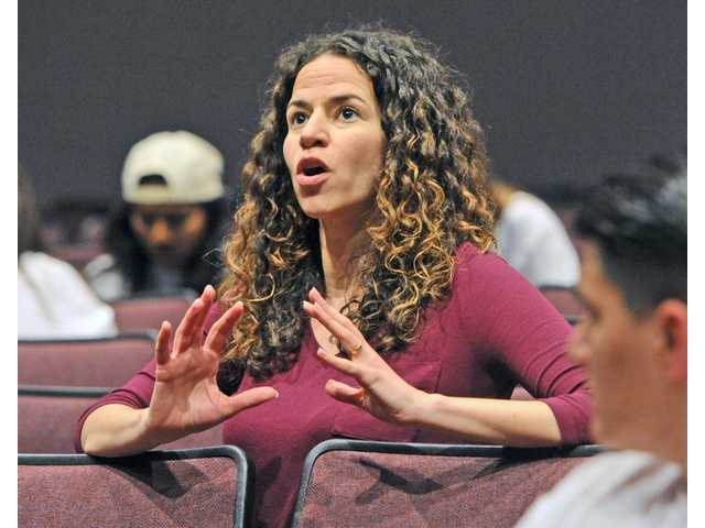 Broadway star Mandy Gonzalez critiques a performance as about 100 drama and choirs students form Valencia and Saugus High Schools rehearse on the stage at Valencia High School on Saturday.  photo by DAN WATSON