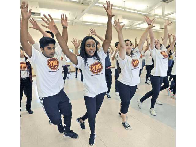 "About 100 drama and chorus student from Valencia and Saugus High Schools rehearse a dance from Broadway show,  ""Newsies"" in the multi-purpose room at Valencia High School on Saturday.  013016  DAN WATSON"