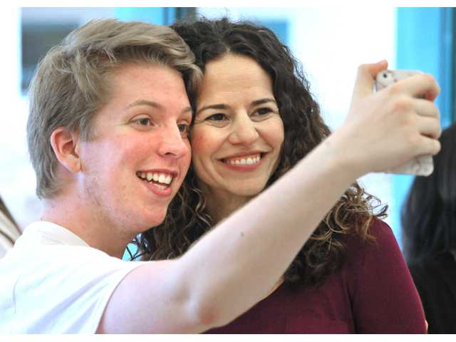 Broadway star Mandy Gonzalez, right, poses for a photo with James Meske, 17,  of Valencia High School during a two-day performance workshop at Valencia High School on Saturday. photo by  DAN WATSON