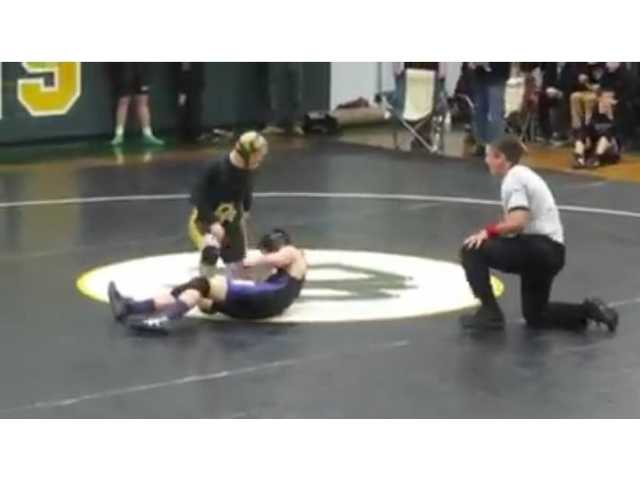 Undefeated high school wrestler lets opponent with Down syndrome win