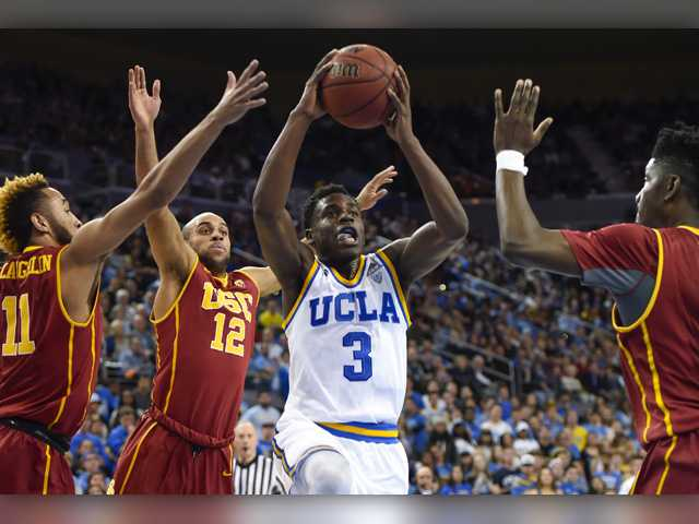 USC beats rival UCLA to go 14-0 at home