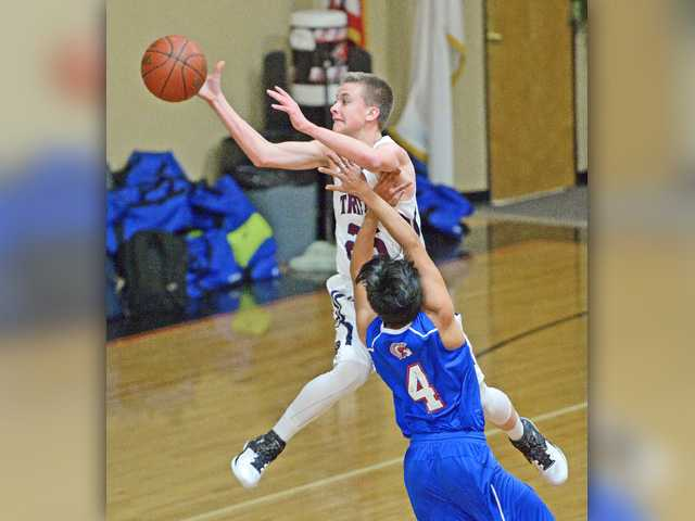Small school roundup: Trinity boys hoops remains spotless in league