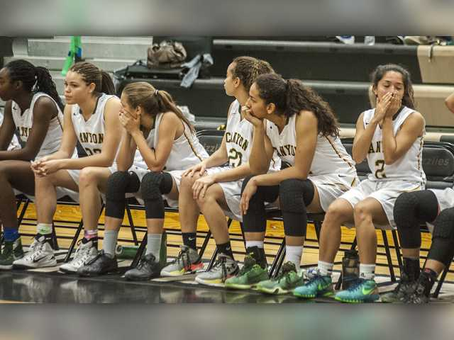 Canyon girls basketball players react to a turnover in the final moments of their CIF State Division 3 second round game against Lakeside at Golden Valley on Saturday. Photo by Tom Cruze/For The Signal