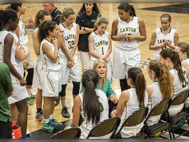 Canyon girls basketball head coach Jessica Haayer addresses her team on Saturday during a timeout in a CIF State Division 3 second round game against Lakeside at Golden Valley. Photo by Tom Cruze/For The Signal