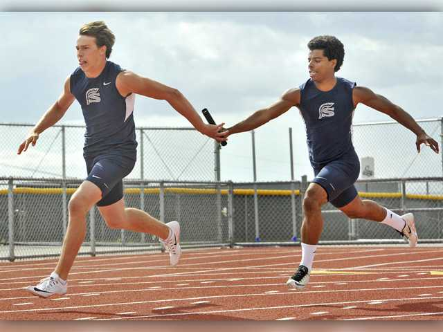 Saugus' 400 meter relay anchor Louis Eusebi takes the baton from third leg runner Amir Bishop during an uncontested race at Golden Valley on Wednesday. Signal photo by Katharine Lotze.