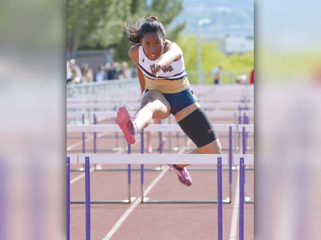 West Ranch Adaugo Oguejiofor wins the Girls Varsity 110m hurdles. Photo by Jayne Kamin-Oncea for The Signal.