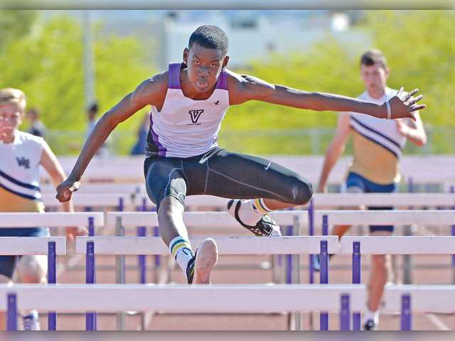 Valencia's Joshua Pikes wins the Boys Varsity 110m hurdles. Photo by Jayne Kamin-Oncea for The Signal.