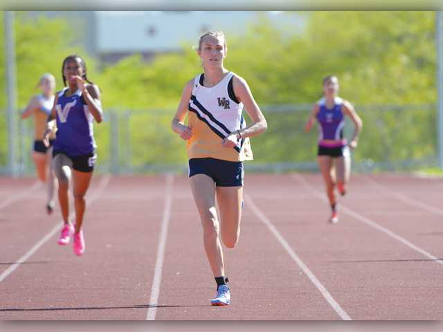 West Ranch's Bailey Pate wins the girls varsity 400 meter race. Photo by Jayne Kamin-Oncea for The Signal.