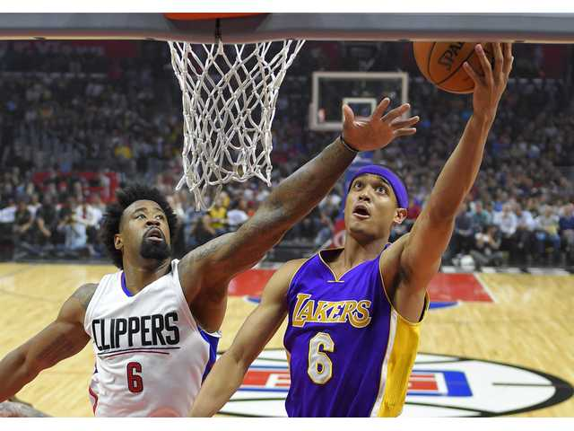 Clippers rout Lakers in first of two games