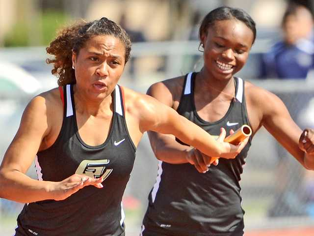 Golden Valley's Azaria Hill takes the first handoff of the 400 meter relay from teammate Lonyaa Merriweather during a dual meet against West Ranch on Wednesday. Signal photo by Katharine Lotze.