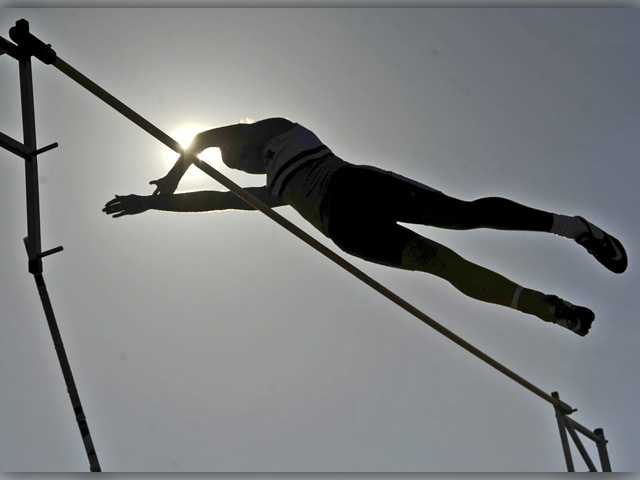 West Ranch's Michael Sorensen clears 10 feet, 3 inches in the boys varsity pole vault at Golden Valley during a dual meet on Wednesday.Signal photo by Katharine Lotze.