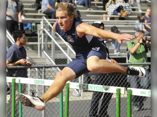 Saugus' Houston Heineman clears the final hurdle in the boys varsity 110 meter hurdles during a dual meet at Canyon on Thursday. Signal photo byKatharine Lotze.