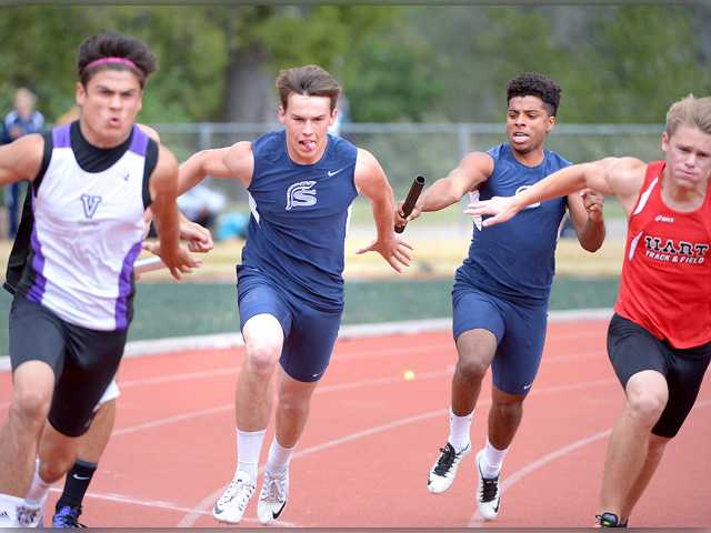 Saugus' Amir Bishop, center-right, hands off the baton to Luis Eusebi, center-left, in the 4x100-meter relayat the Foothill League track finals at College of the Canyons. Jayne Kamin-Oncea for The Signal