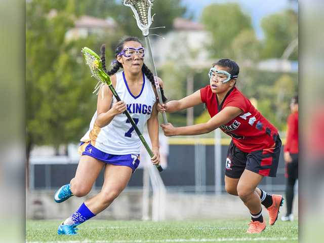 Valencia's Mandy Yamamoto, left, puts the Vikings ahead 5-4 with her goal in the second half of their  the U.S. Lacrosse Southern Section Los Angeles Division 2 semifinals at Valencia on Friday against Glendale High School. Valencia lost 9-6. Photo by Tom Cruze for The Signal.