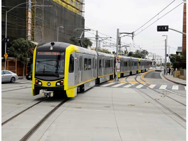 A test train at the new Metro Expo Line in Santa Monica is shown on Wednesday. Starting Friday, riders can now take Metro rail from the far-inland suburb of Azusa some 40 miles to the sands of Santa Monica.