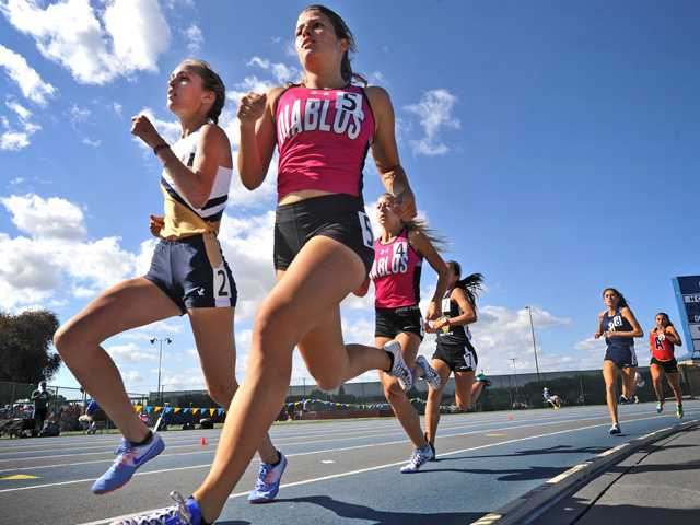 West Ranch's Bailey Pate, left, goes toe to toe with Mission Viejo's Taylor Arco in the 800 meter run at the CIF Southern Section track and field finals at Cerritos College in Norwalk on Saturday.Signal photo by Katharine Lotze