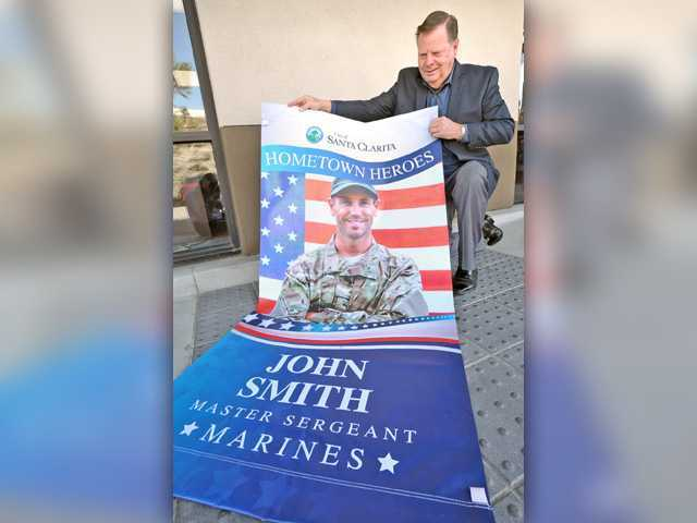 Local businesses lower cost of hometown heroes banner