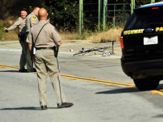 California Highway Patrol officers investigate a cyclist's death on Placerita Canyon Road near Highway 14 on Wednesday. Signal photo by Katharine Lotze