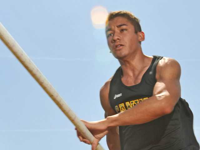 Canyon pole vaulter Jeremiah Chow is clearing the bar