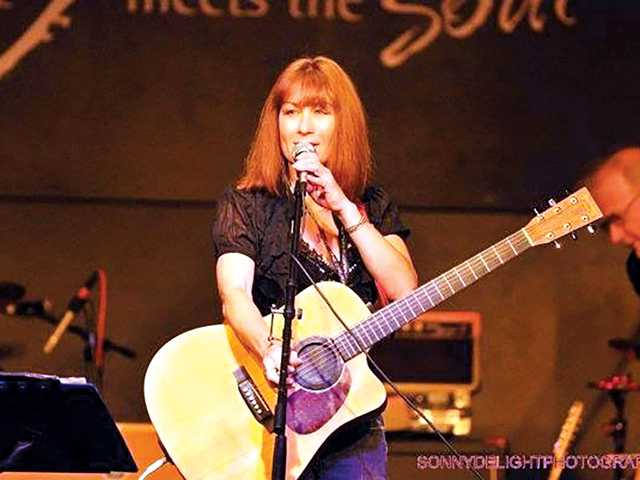 • Singer/Songwriter Susan Rey performing at the Canyon Club. Courtesy photo
