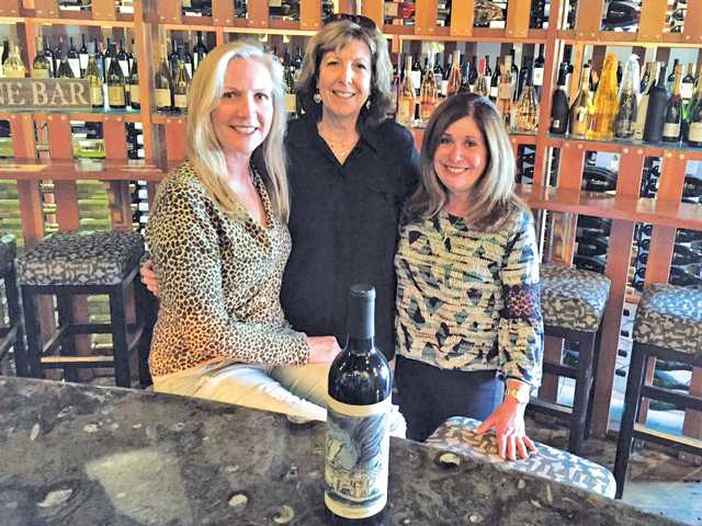 • (L-R:) Eve Bushman, Beth Greenwald and Danise Davis recently earned a certification in the first globally-recognized course on American wine. Courtesy photo