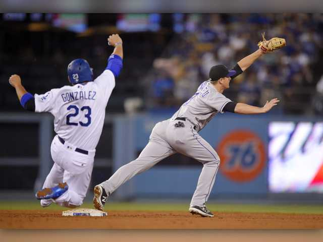 Rockies throw 4-hitter in win over Dodgers