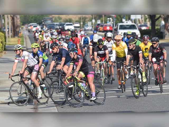 An estimated 300 riders turn into the Santa Clarita City Hall Parking lot from Valencia Boulevard as they participate in the Rod Bennett Memorial Bike Ride on Saturday. Signal photo by Dan Watson.