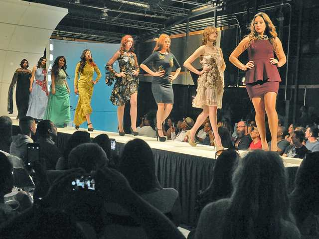 """Dozens of attendees watch a fashion show during the """"Vet 50"""" event held at LIMS Movie Studios in Castaic on Saturday. 061816 DAN WATSON"""