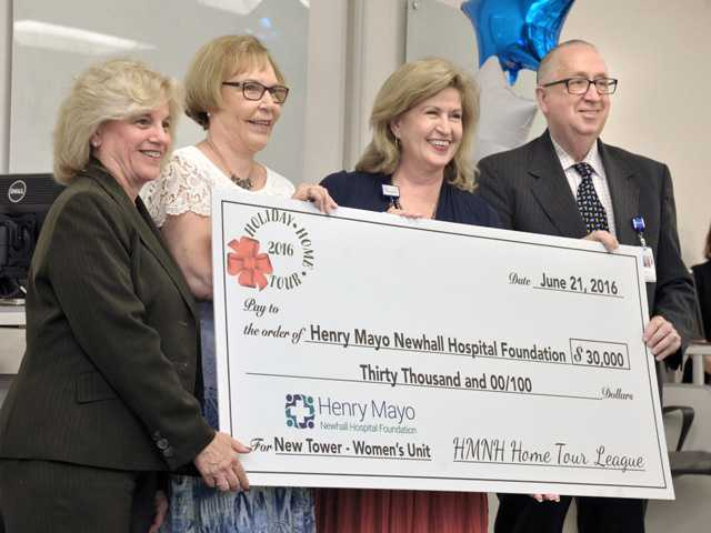 Check for $30,000 presented to Henry Mayo Foundation