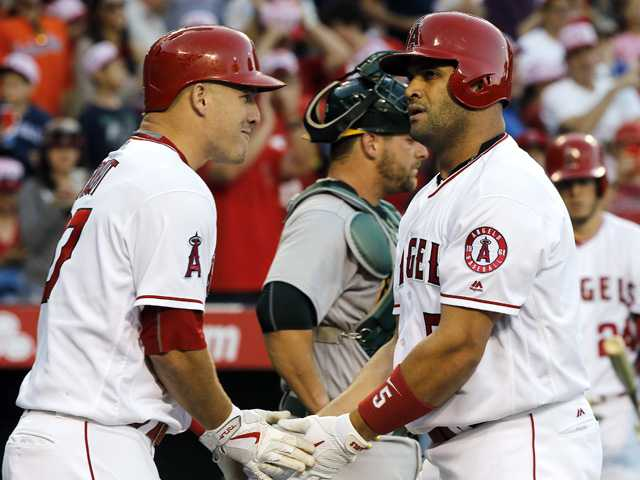 Pujols makes history in Halos loss