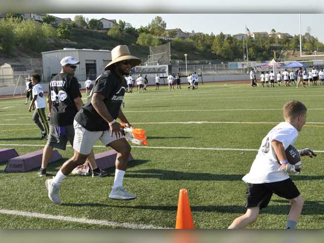 Shane and Brock Vereen host 3rd-annual football camp at Valencia High