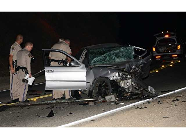 Officers with the California Highay Patrol investigate a fatal crash on Sierra Highway early Wednesday morning. Photo by Rick McClure, for The Signal.