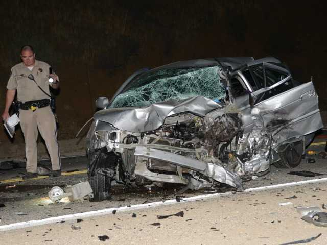 An Officer with the California Highay Patrol investigates a fatal crash on Sierra Highway early Wednesday morning. Photo by Rick McClure, for The Signal.