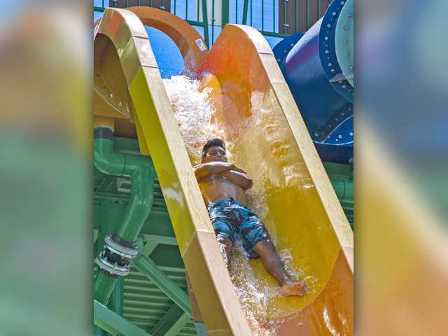 Debut of new slide at Hurricane Harbor draws chill-out crowd