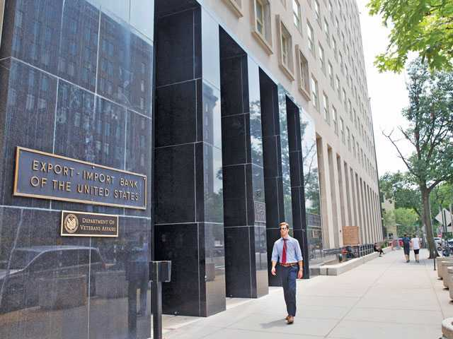 A man passes by the Export-Import Bank of the United States in Washington on July 28, 2015. Associated Press photo