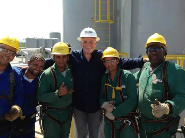 Steve Wilburn, CEO of Firm Green, stands center at the project in Brazil which is now delayed due to a lack of quorum on the Ex-Im Bank to approve financing for the firm's project to continue. Couetsy photo.