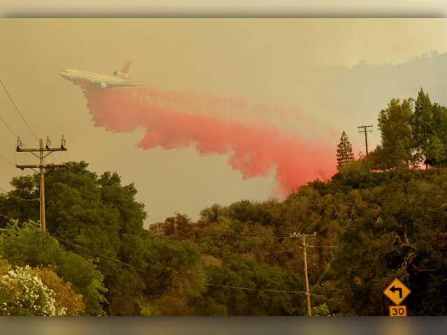 A phos-check fire retardant drop on Saturday. Signal Photo by Dan Watson