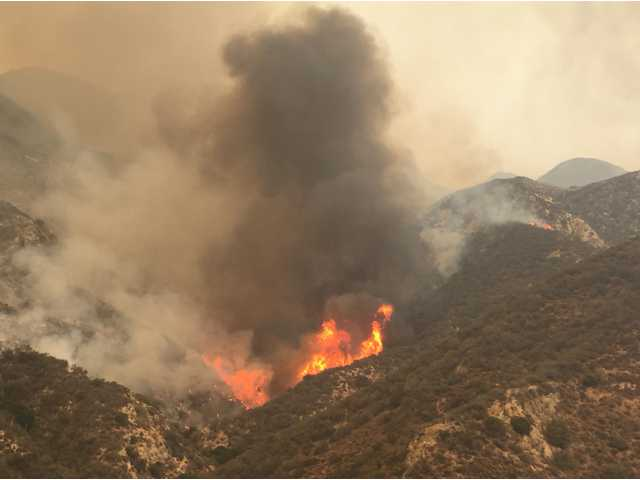 Fire burns in Little Tujunga Canyon on Saturday. Signal Photo by Katharine Lotze
