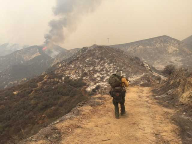 Simeon Hagens, an Angeles National Forest firefighter heads to an area off Little Tujunga Canyon Road. Signal Photo by Katharine Lotze