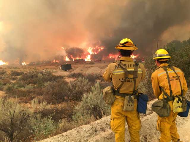 Firefighters observe as the Sand Fire burns through Acton, threatening a home near Soledad Canyon Road. Signal photo by Austin Westfall